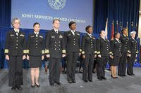 Members of the USPHS Commissioned Corps receive their DoD Humanitarian Service Medal during a Nov. 15, 2018 ceremony at the U.S. Department of Health and Human Services building in Washington, D.C. (Tony Lombardo/MOAA)