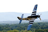 A P-51 Mustang fighter performs during the Thunder Over the Blue Ridge Open House and Air Show in West Virginia. Two veterans died on Saturday when their Mustang crashed during an airshow in Texas. (US Air Force photo/Sean Brennan)
