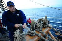 U.S. Coast Guard Barque Eagle crewman Petty Officer 1st Class John Presnar handles a line while adjusting sails aboard the Eagle, Sept. 17, 2012. (U.S. Coast Guard photo/Lauren Jorgensen)
