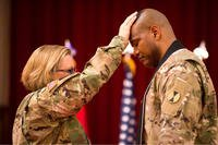 Lt. Col. Khallid Shabazz, right, participates in his Change of Stole ceremony inside the Lewis Main Chapel at Joint Base Lewis-McChord, Wash., May 23, 2017. Shabazz became the chaplain for the 7th Infantry Division during the ceremony, making him the Army's first Islamic chaplain at the division level. (Courtesy photo)