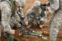Soldiers prepare old munitions for destruction during controlled detonation operations on Forward Operating Base Delta in southern Iraq, Oct. 31, 2009 (U.S. Army Photo/Staff Sgt. Brien Vorhees)