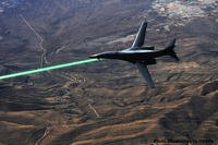 The Pentagon may develop laser weapons in the future. DARPA photo illustration