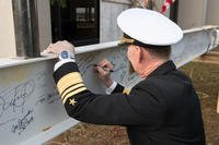 "Vice Admiral Walter E. ""Ted"" Carter, 62nd Superintendent of the United States Naval Academy, signs the I beam during the topping out ceremony which will be part of the top floor of Hopper Hall, November 30, 2018. (U.S. Navy photo/Kenneth D. Aston Jr.)"
