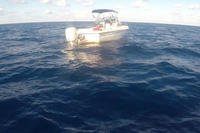 A 20-foot boat floats on the water Jan. 19, 2019 approximately 30 miles east of Sunny Isles, Florida. The Coast Guard Cutter Bernard C. Webber (WPC-1101) crew interdicted the boat with six people, which included four people who did not have current U.S visas attempting to illegally enter the United States. (U.S. Coast Guard photo)