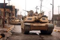 U.S. Army M1A2 Abrams tanks maneuver in the streets as they conduct a combat patrol in the city of Tall Afar, Iraq, on Feb. 3, 2005. DoD photo.