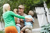 Servicemember with his family.
