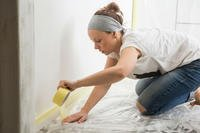 woman prepping to paint a wall