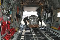 Loadmasters from the 186th Airlift Squadron secure a training cargo load aboard a Montana Air National Guard C-130 cargo aircraft. (U.S. Air National Guard/Tech. Sgt. Michael Touchette)