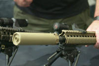 Surefire shows off their new suppressors. (Screengrab from Military.com video)