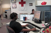 An American Red Cross worker process an emergency message from the Red Cross emergency message hotline. (Photo: American Red Cross)