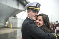 A Sailor greets his wife after returning home aboard the USS Wasp (LHD 1) as part of the Wasp Amphibious Ready Group (WSP ARG) homecoming from a deployment, Dec. 24, 2016. (U.S. Navy photo/Mass Communication Specialist 2nd Class Andrew Schneider)