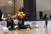 U.S. Army veteran Christy Gardner and Master Sgt. Jovan Bowser  warm-up before a seated volleyball competition for the 2017 Department of Defense Warrior Games at Chicago, Ill., June 30, 2017. (U.S. Army photo/Pfc. Genesis Gomez)
