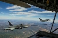 A Eurofighter Typhoon with the Spanish Air Force receives fuel from a U.S. Marine KC-130J Hercules with Special-Purpose Marine Air-Ground Task Force Crisis Response-Africa, August 13, in Spain. (Photo: Staff Sgt. Vitaliy Rusavskiy)