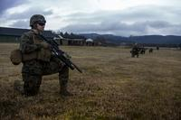 U.S. Marine Lance Cpl. Raymond Jastrzebski Jr., a rifleman with Marine Rotational Force Europe 17.1 takes a tactical pause during a squad patrol in Vaernes Garnison, Norway, April 7, 2017. (U.S. Marine Corps/Lance Cpl. Sarah N. Petrock)