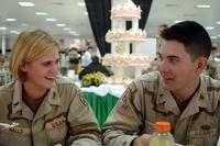 Dual deployed soldiers eating cake.