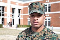 Marine standing on college campus