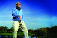Arnold Palmer on golf course