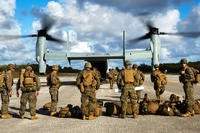 Marines disembark from An MV-22B Osprey at North Field on Tinian, part of the Mariana Islands chain that includes Guam. (US Marine Corps photo/Antonio Rubio)
