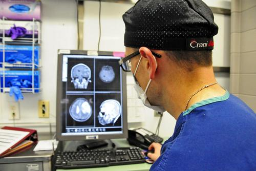 FILE-- U.S. Air Force Maj Jonathan Forbes, 455 Expeditionary Medical Operations Squadron neurosurgeon reviews magnetic resonance imaging of a patient (U.S. Air Force photo)