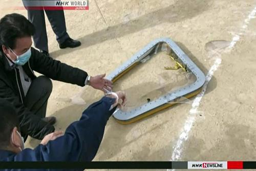 This image from an NHK broadcast shows a window from a CH-53E Super Stallion helicopter after it fell onto an elementary school sports field near Marine Corps Air Station Futenma, Okinawa, on Dec. 13, 2017. Screenshot from NHK