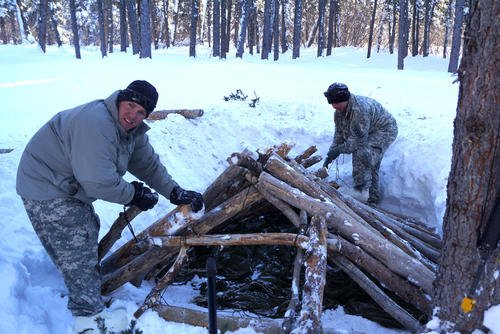 Army soldiers build a shelter at the Northern Warfare Training Center in Alaska. Marines may start training there, too. (DoD photo/Michael O'Brien)