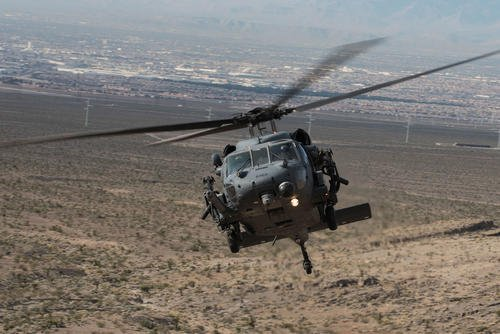 An HH-60G Pave Hawk helicopter, assigned to the 66th Rescue Squadron, flies during training on Nellis Air Force Base, Nevada, Feb. 22, 2018. (U.S. Air Force/Kevin Tanenbaum)