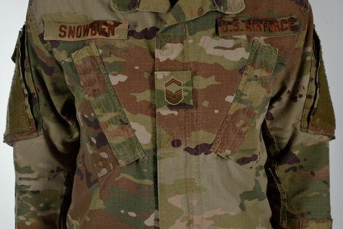 "The U.S. Air Force is adopting the Army's Operational Camouflage Pattern as its new combat uniform and will begin incrementally phasing it in beginning Oct. 1. The Air Force will differentiate itself from the Army by using a ""spice brown color"" for velcro patches, name tape and insignia. Courtesy of Air Force"