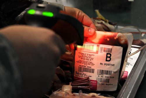Blood bags are scanned into a computer-based tracking system at the 379th Air Expeditionary Wing's Blood Transshipment Center in Southwest Asia. (US Air Force photo/Bahja J. Jones)