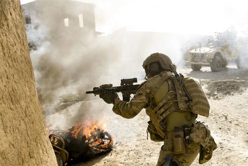 A U.S. Special Operations soldier returns fire while conducting multi-day Afghan-led offensive operations against the Taliban in Mohammad Agha district, Logar Province, Afghanistan, July 28, 2018. (U.S. Air Force/Staff Sgt. Nicholas Byers)