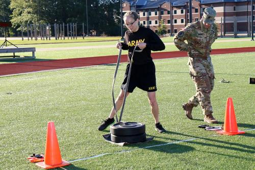 Capt. McKenzie Hensley demonstrates the 90-pound led drag portion of the sprint-drag-carry event of the Army Combat Fitness Test. (Military.com/Matthew Cox)