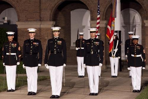 A parade staff with Marine Barracks Washington, D.C., stands in their position during a Friday Evening Parade at the Barracks May 31, 2013. (Dengrier Baez/Marine Corps)